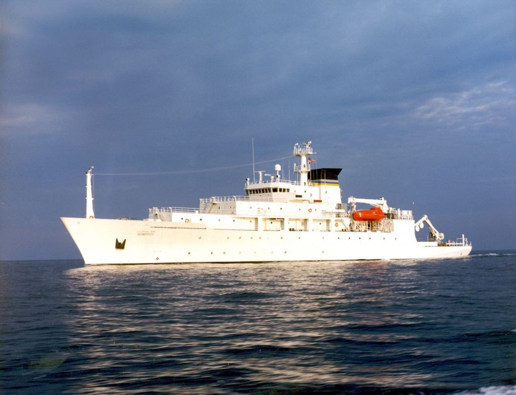In this undated photo released by the U.S. Navy Visual News Service, the USNS Bowditch, a T-AGS 60 Class Oceanographic Survey Ship, sails in open water. The USNS Bowditch, a civilian U.S. Navy oceanographic survey ship, was recovering two drones on Thursday when a Chinese navy ship approached and sent out a small boat that took one of the drones, said Navy Capt. Jeff Davis, a Pentagon spokesman. He said the Chinese navy ship acknowledged radio messages from the Bowditch, but did not respond to demands the craft be returned. (CHINFO, Navy Visual News via AP)