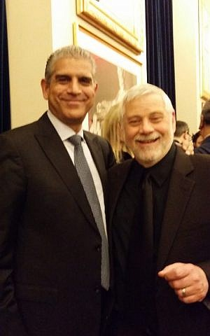 Author Edwin Black, right, poses for a selfie with PLO envoy Maen Areikat at a Hanukkah party at the Trump International Hotel in Washington, D.C., Dec. 14, 2016. (Courtesy of Edwin Black, via JTA)