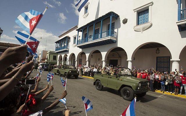 The caravan driving the ashes of Cuba's leader Fidel Castro arrives at the Cespedes Park in Santiago, Cuba, Saturday, December 3, 2016. (AP Photo/Ricardo Mazalan)