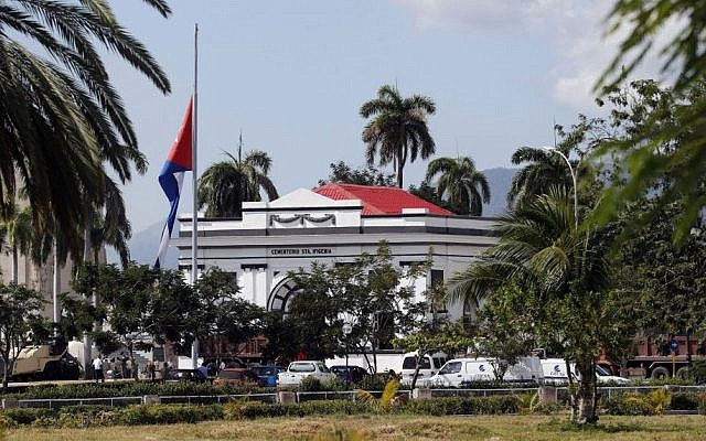 A Cuban national flag is at half-staff outside the Santa Ifigenia cemetery, in Santiago, Friday, December 2, 2016, where the ashes of the late Cuban leader Fidel Castro will be laid to rest. (AP Photo/Dario Lopez-Mills)