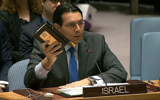 Israeli Ambassador to the UN, Danny Danon, holds up a Bible as he speaks to the UN Security Council after it passed an anti-settlement resolution, December 23, 2016 (Courtesy: UN)