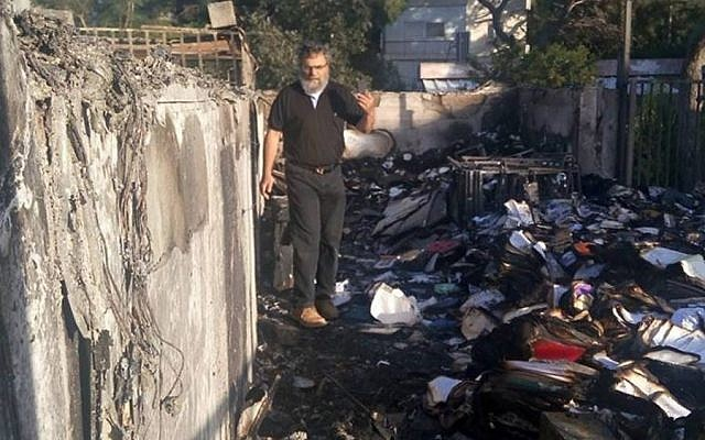Rabbi Dov Hiyon in the fire-devastated rubble of the Haifa Conservative Synagogue (Facebook)
