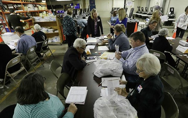 Workers begin a statewide presidential election recount Thursday, Dec. 1, 2016, in Milwaukee, Wisconsin. (AP Photo/Morry Gash)