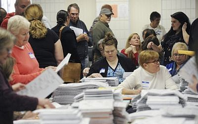 Workers recount Berrien County presidential ballots Wednesday, Dec. 7, 2016, at the South County Courthouse in Niles, Mich. (Don Campbell/The Herald-Palladium via AP)