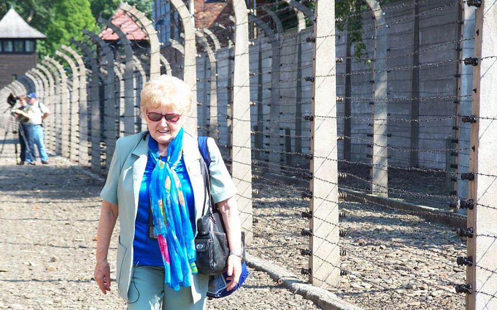 Former inmate and Mengele twin, Eva Mozes Kor walks the grounds at Auschwitz in 2007, on one of her many trips there as a lecturer. (courtesy)