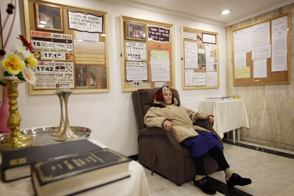 An elderly Russian woman sits in the reception of the Diplomat Hotel in Jerusalem, a possible site for the US Embassy. (Miriam Alster/FLASH90)
