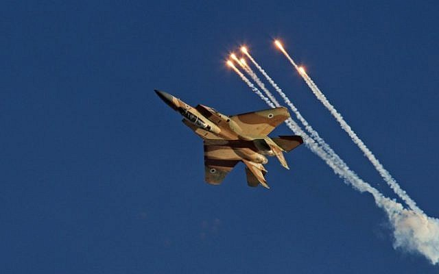 An F-15I fighter jet performs an acrobatic display during a ceremony in the Hatzerim Air Base near Beersheba on June 23, 2013. (Ofer Zidon/Flash90)