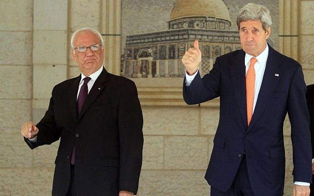 US Secretary of State John Kerry (R) seen with chief Palestinian negotiator Saeb Erekat at the Palestinian Presidential compound in Ramallah on July 23, 2014. (Issam Rimawi/Flash90)