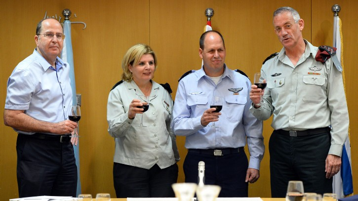 From left, then-defense minister Moshe Ya'alon, Maj. Gen. (res.) Orna Barbivai, Maj. Gen. Hagai Topolanski and former IDF chief of staff Benny Gantz raise a toast in a ceremony as Topolanski takes over as head of the IDF Manpower Directorate, at army headquarters in Tel Aviv on September 8, 2014. (IDF Spokesperson/FLASH90)