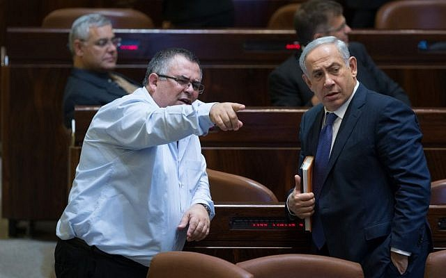 Prime Minister Benjamin Netanyahu speaks with MK David Bitan in the Knesset plenum, November 18, 2015 (Yonatan Sindel/Flash90)