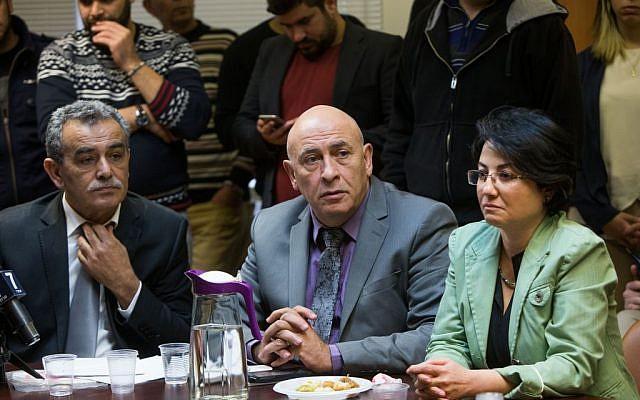 Joint Arab List members Jamal Zahalka (L), Hanin Zoabi (R) and Basel Ghattas at the weekly Joint Arab list meeting at the Knesset, Israel's parliament in Jerusalem on February 8, 2016. (Yonatan Sindel/Flash90)