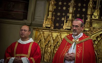 Pierbattista Pizzaballa (r) during the ceremony honoring his entry as Apostolic Administrator at the Latin Patriarchate Church in Jerusalem's Old City, on September 21, 2016. (Hadas Parush/Flash90)