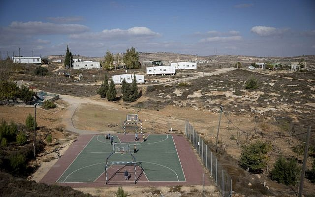 Children play soccer near trailer homes at the unauthorized Israeli outpost of Amona, in the West Bank, on November 17, 2016. (Miriam Alster/Flash90)
