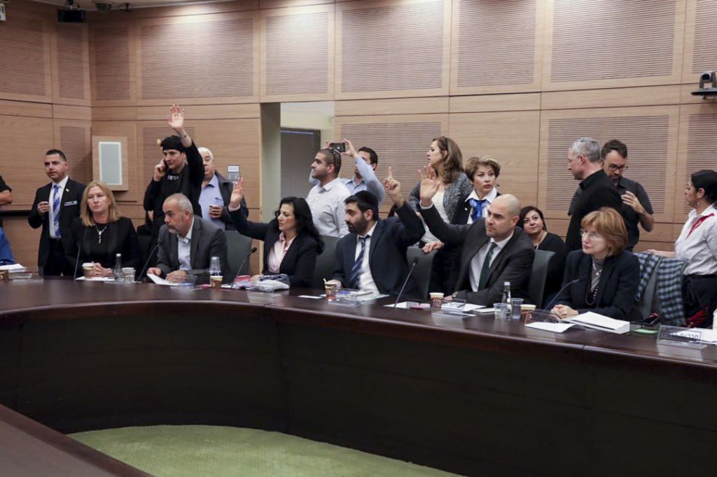 Israeli parliament members vote during a Constitution, Law, and Justice, Committee meeting regarding the so-called Regulation Bill, which is designed to avert the court-ordered demolition of the West Bank outpost of Amona, in the Knesset on November 30, 2016. (Issac Harari/Flash90)