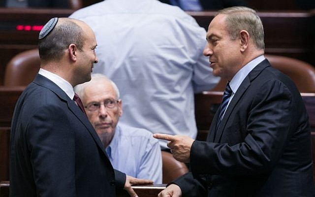 Prime Minister Benjamin Netanyahu speaks with Education Minister Naftali Bennett during a plenum session in the Knesset on December 5, 2016. (Yonatan Sindel/Flash90)