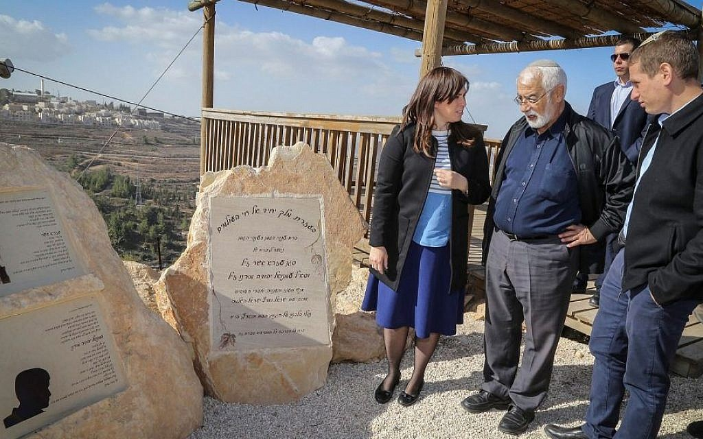Deputy Foreign Minister Tzipi Hotovely seen with the father and brother of Emmanuel Moreno stands by his memorial monument at the Netiv Ha'avot outpost in Gush Etzion, on December 6, 2016. (Gershon Elinson/Flash90)