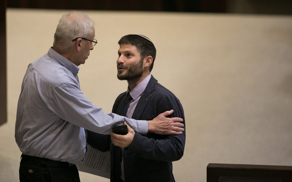 Jewish Home MK Bezalel Smotrich, right, speaks with Likud MK Benny Begin during a vote on the so-called Regulation Bill on December 7, 2016. (Yonatan Sindel/Flash90)