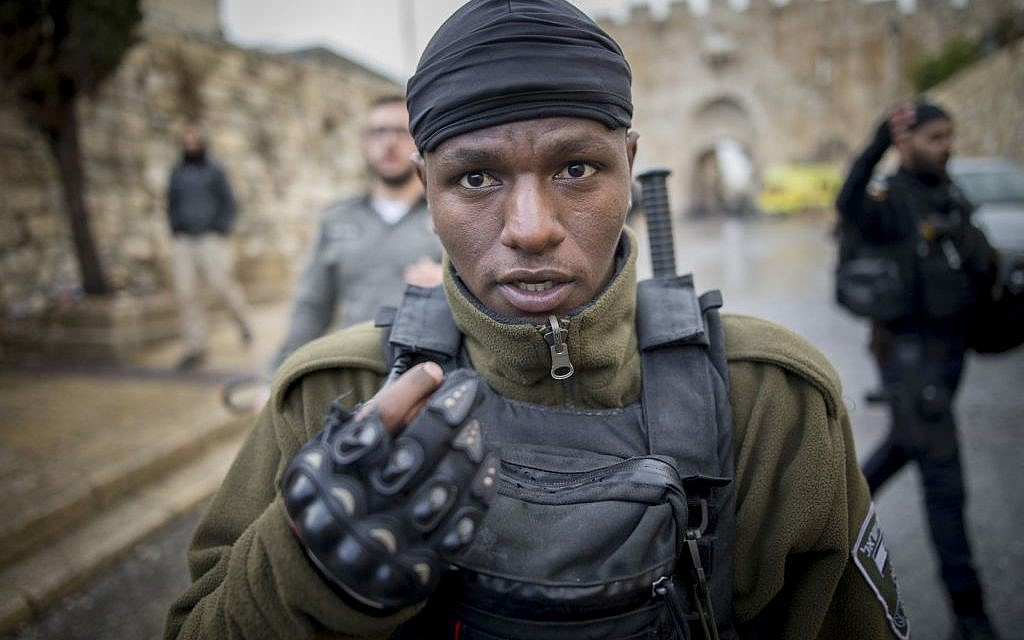 An Israeli soldier gestures at the scene of a stabbing attack in Jerusalem on December 14, 2016. in which a Palestinian stabbed a policemen before before being neutralized by police. (Photo by Yonatan Sindel/Flash90)