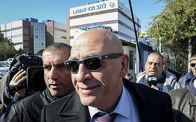 Joint Arab List member Basel Ghattas arrives at the Lahav 433 investigation unit in Lod, December 20, 2016. Ghattas is suspected of smuggling cell phones to Palestinian security prisoners last week. (Flash90)