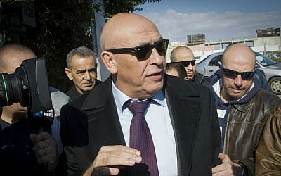MK Basel Ghattas arrives at the Israel Police's Lahav 433 special investigation unit in Lod, December 20, 2016, for questioning. (Roy Alima/Flash90)