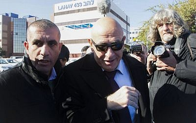 Joint (Arab) List member MK Basel Ghattas, center, arrives at the police Lahav 433 investigation unit in Lod, December 20, 2016. (Roy Alima/Flash90)