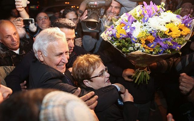 Former president Moshe Katsav, accompanied by his wife Gila, arrives in his hometown of Kiryat Malachi on December 21, 2016, after his release from prison where he served five years of a seven-year rape sentence (Photo by Hadas Parush/Flash90)