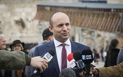 Education Minister and Jewish Home party leader Naftali Bennett delivers a statement to the press in response to the UN vote against Israeli settlements, at the Western Wall in Jerusalem's Old City, on December 25, 2016. (Hadas Parush/Flash90)