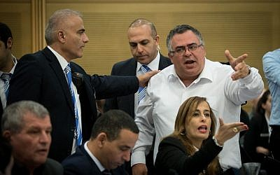 MK David Bitan is taken out by security guards during a Knesset Committee meeting discussing the allegations against Joint (Arab) List MK Basel Ghattas, September 21, 2016. (Yonatan Sindel/Flash90