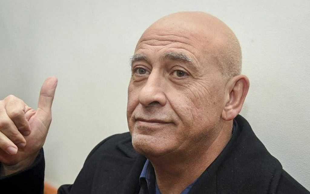 Joint (Arab) List member Basel Ghattas is brought to court for a remand on his arrest at the Rishon Lezion Magistrate's Court, December 27, 2016. (Yair Sagi/POOL)