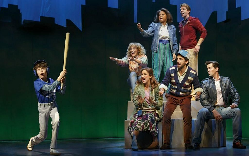 """Clockwise from left: Anthony Rosenthal, Betsy Wolfe, Tracie Thoms, Christian Borle, Andrew Rannells, Brandon Uranowitz and Stephanie J. Block performing in the musical """"Falsettos."""" (Joan Marcus/via JTA)"""