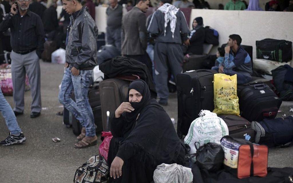 Illustrative photo of Palestinian woman who sits next to her luggage as she waits to cross to the Egyptian side of the Rafah border crossing, in Rafah, Gaza Strip, October 19, 2016. (AP Photo/Adel Hana, File)