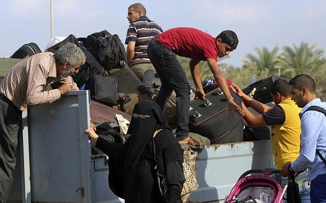 Palestinians put their luggage on a cart to cross the border to Egypt, in Rafah, Gaza Strip, October 19, 2016. (AP Photo/Adel Hana, File)