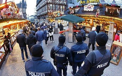 German police officers patrol the Christmas market in Frankfurt, Germany, Tuesday, Dec. 20, 2016. (AP Photo/Michael Probst)