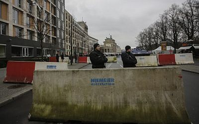 Armed police officers stand behind concrete blocks for protection near the Brandenburg Gate in Berlin, December 23, 2016, after Anis Amri, the suspect of the terrorist attack on a Christmas market in Berlin was shot in Milan, Italy. (AP Photo/Markus Schreiber)