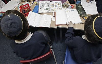 Pupils of North Cheshire Primary listen to a teacher during a  class on December 7, 2006, Stockport, England. (Christopher Furlong/Getty Images via JTA)