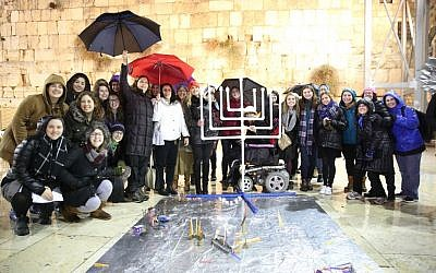 Women of the Wall light Hanukkah candles at the Western Wall, 27 December, 2016 (Miri Tzach/Women of the Wall)