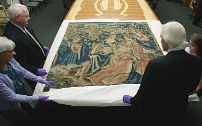 The 16th century tapestry that had been in Adolf Hitler's retreat in the Bavarian Alps being examined in the National World War II Museum in New Orleans, November 7, 2016. (History Canada & More4 via AP)