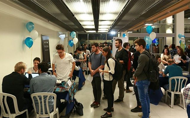 """IDC students at a """"speed-dating"""" with startups event in Nov. 2016 (Courtesy Adi Cohen Zedek)"""