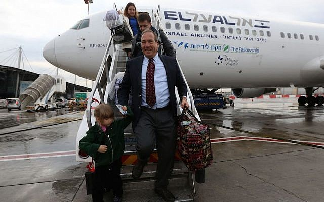 Rabbi Yechiel Eckstein exiting the first aliyah flight organized by the the International Fellowship of Christians and Jews, December 2014. (Courtesy of the International Fellowship of Christians and Jews)