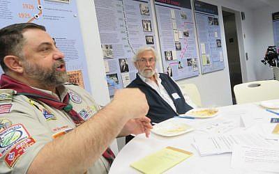 Abdul Rashid Abdullah of the National American Muslim Association on Scouting speaking at a Muslim-Jewish gathering in Washington, D.C., while Rabbi David Shneyer of Kehila Chadasha looks on, Dec. 11, 2016. (Ron Kampeas/JTA)