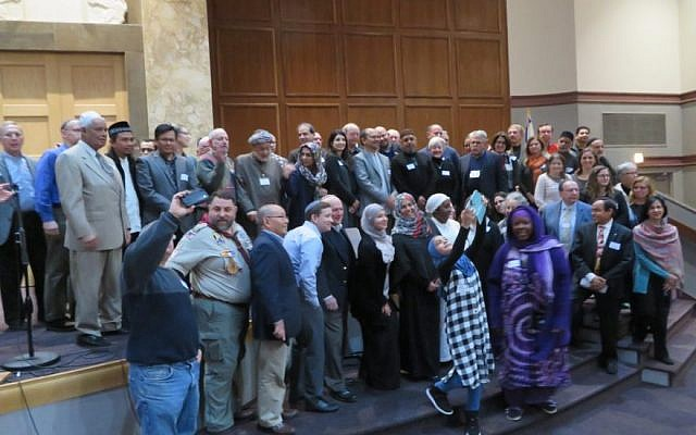 Imams, rabbis, and Jewish and Muslim lay leaders posing for a group photo at Congregation Tifereth Israel in Washington, D.C., Dec. 11, 2016. (Ron Kampeas/JTA)