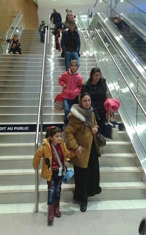Two Yazidi families being greeted by local volunteers after a privately sponsored mission called Operation Ezra brought them to Winnipeg, Manitoba on December 20, 2016 (Nafiya Naso)