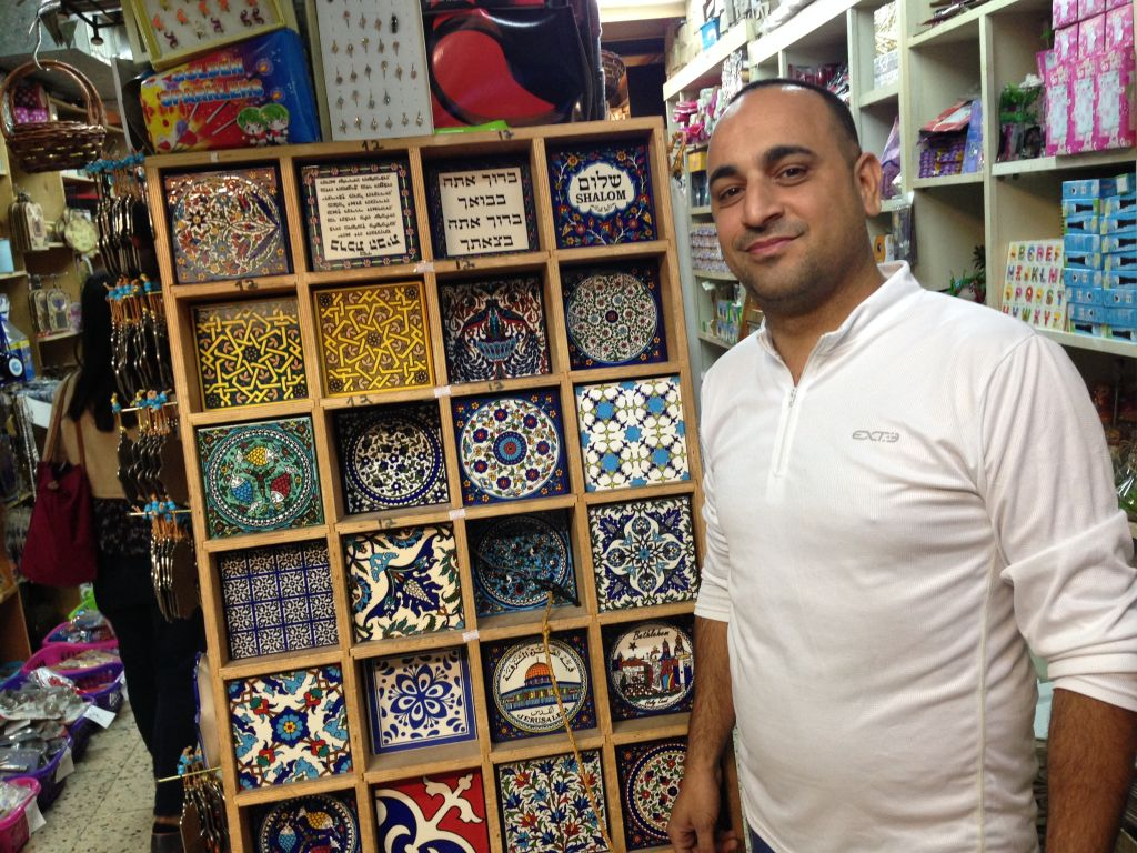 Pahcer (pronounced Faher) and Siuri in his City of Presents store on the main street of the Old Jaffa market. (Brett Kline/Times of Israel)