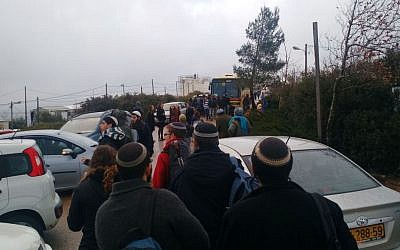 Protesters leaving Amona on December 18, 2016. (Judah Ari Gross/Times of Israel)