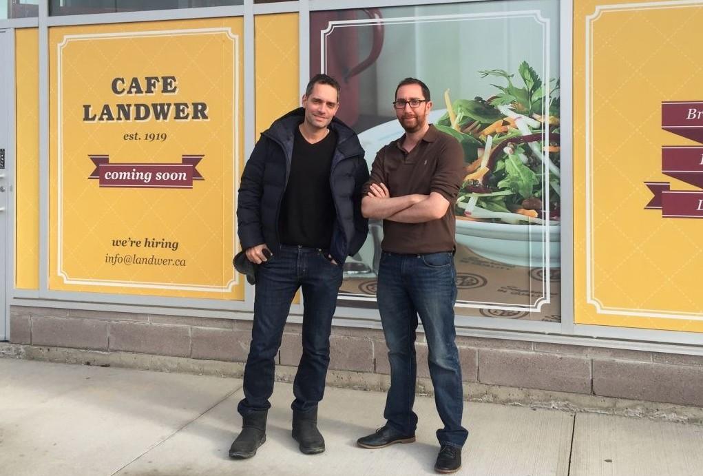 Eran Shram (left) and Niv Feldman, both Israeli-Canadians, in front of their flagship Cafe Landwer location in Toronto. (Courtesy)