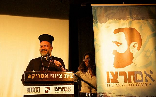 Father Gabriel Naddaf speaking on December 11, 2016, at the fourth annual Im Tirtzu 'Zionist Conference for Human Rights' in Tel Aviv. (Dov Lieber / Times of Israel)
