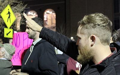 Illustrative. A man performs the Nazi salute outside an event hall at Texas A&M University on December 6, 2016, where the leader of the so-called alt-right movement, Richard Spencer, was speaking. (Ricky Ben-David/Times of Israel)