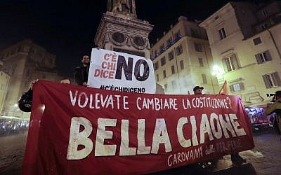 "Anti-referendum militants gather in downtown Rome after Italian Premier Matteo Renzi conceded defeat in a constitutional referendum and announced he will resign in Rome, early Monday, Dec. 5, 2016. Banner in Italian reads ""You wanted to change the Constitution? Goodby Bella"". (AP/Gregorio Borgia)"
