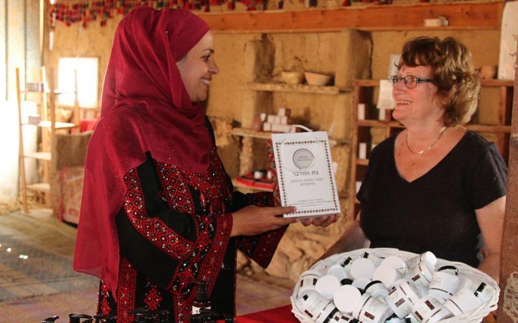 Mariam Abu Rakaek hosts a guest in her visitors' center, Daughter of the Desert, in the village of Tel Sheva. (Shmuel Bar-Am)