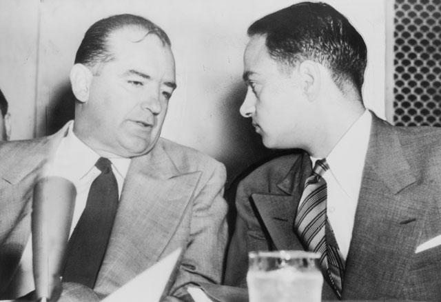 Senator Joseph McCarthy (left) speaks with attorney Roy Cohn. (Public domain)